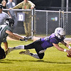 (Brad Davis/The Register-Herald) James Monroe's Jacob Mann reaches for the pylon and beats Wyoming East defender Jacob Bishop for a 2nd quarter touchdown Friday night in Lindside.