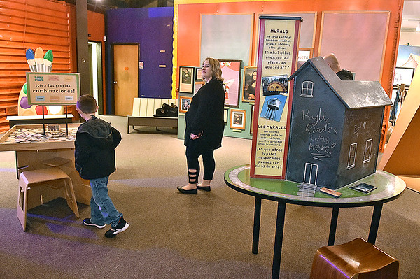 """(Brad Davis/The Register-Herald) Visitors browse the Youth Museum as they explore its new exhibit, """"Framed, Step into the Art,"""" November 24."""