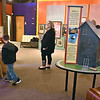 "(Brad Davis/The Register-Herald) Visitors browse the Youth Museum as they explore its new exhibit, ""Framed, Step into the Art,"" November 24."