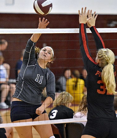 (Brad Davis/The Register-Herald) Independence's Ashleigh Sexton spikes the ball as PikeView's Laken McKinney tries to block it during Shirley Brown Invitational action Saturday morning at Woodrow Wilson High School.