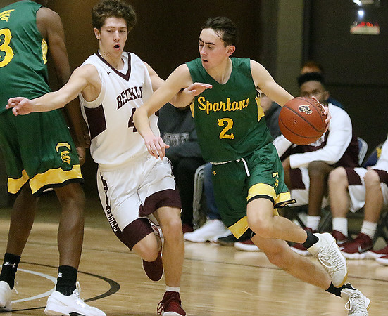 (Brad Davis/The Register-Herald) Greenbrier East's Seth Brown moves along the perimeter as Woodrow Wilson's Danny Bickey defends Saturday night at the Beckley-Raleigh County Convention Center.