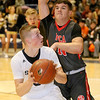 (Brad Davis/The Register-Herald) Shady Spring's Stephen Williams turns to shoot as Poca defender Ethan Payne applies pressure Wednesday night inside the Tigers' brand new gym.
