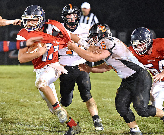 (Brad Davis/The Register-Herald) Independence's Phillip Spurlock II carries the ball as Summers County's Marcus McGuire tries to bring him down Friday night in Coal City.