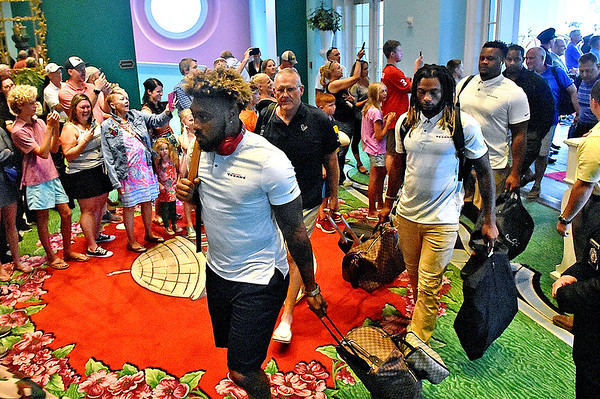 (Brad Davis/The Register-Herald) Houston Texans players arrive at the Greenbrier Resort hotel Wednesday afternoon in White Sulphur Springs.