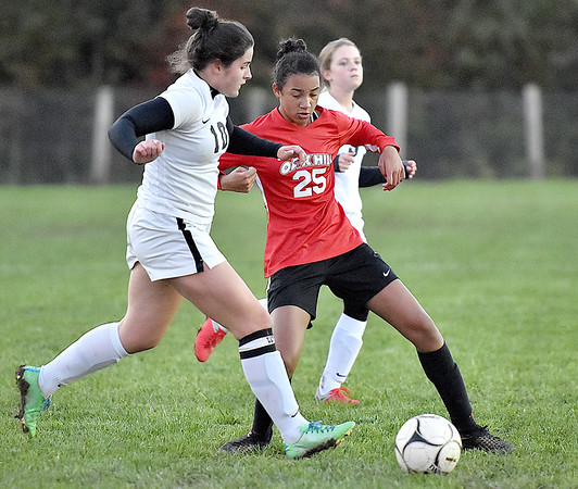 (Brad Davis/The Register-Herald) Oak Hill's Samiah Lynch battles for possession with PikeView's Ruby Cole Wednesday night in Oak Hill.