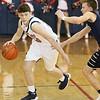 (Brad Davis/The Register-Herald) Independence's Zach Bolen drives up the court as Greenbrier West's Noah Midkiff defends Friday night in Coal City.