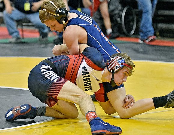 (Brad Davis/The Register-Herald) Independence's John Sanders takes on Liberty Harrison's Ryan Murphy in a 106-pound weight class matchup during state wrestling tournament action Thursday night at Huntington's Big Sandy Arena.