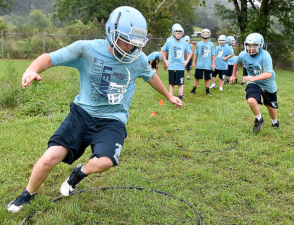 (Brad Davis/The Register-Herald) Meadow Bridge players work through agility drills during preseason football practice Wednesday afternoon.