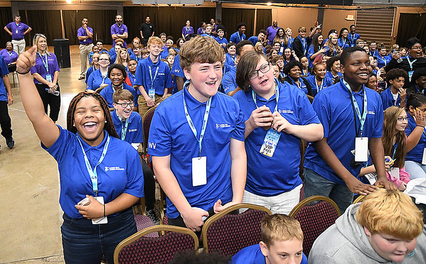 Raleigh County Middle School students react when NFL Pro Football Hall of Famer's, Randy Moss, Darrell Green, and Aeneas Williams hit the stage during the Youth Summit held at the Beckley-Raleigh Convention Center Friday morning.<br /> (Rick Barbero/The Register-Herald)