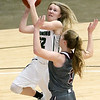 (Brad Davis/The Register-Herald) Wyoming East's Gabby Lupardus drives and scores as George Washington's Kalissa Lacy defends during Big Atlantic Classic action Saturday the Beckley-Raleigh County Convention Center.