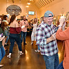 (Brad Davis/The Register-Herald) Patrons dance and groove the evening away as the D.J. spins tunes inside the main room area of Weathered Ground Brewery during their 2nd Annual Oktoberfest Saturday afternoon in Cool Ridge.