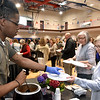 (Brad Davis/The Register-Herald) Beckley resident Linda Ramsey, right, gets a cup of soup from Dobra Zupa cook Cameron Hallcomb, left,  during Beckley Quota Club's annual Empty Bowls fundrasing event Saturday afternoon inside The Place at United Methodist Temple.