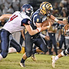 (Brad Davis/The Register-Herald) Shady Spring's Haven Chapman rumbles ahead for a big gain as Independence's Isaiah Duncan gives chase Thursday night in Shady Spring.