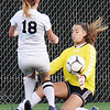Woodrow's goalkeeper Jordan Lilley makes a save on Oak Hill's (18) during their soccer match Tuesday in Beckley. (Chris Jackson/The Register-Herald)