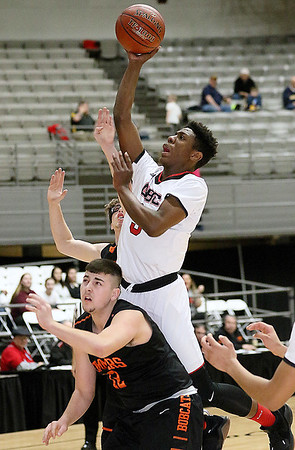 (Brad Davis/The Register-Herald) Greater Beckley Christian's Orlando Potter drives and scores as Summers County's Ashton Bennett defends during the Crusaders' win over the Bobcats Friday night at the Beckley-Raleigh County Convention Center.