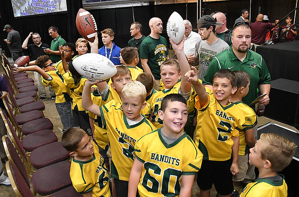 Members of the Southwest Bandits football team in Beckley hold up autographed footballs during the Youth Summit held at the Beckley-Raleigh County Convention Center. Guest speakers were, former North Carolina basketball player, Iman McFarland, NFL Pro Football Hall of Famer's, Randy Moss, Darrell Green, and Aeneas Williams.<br /> (Rick Barbero/The Register-Herald)