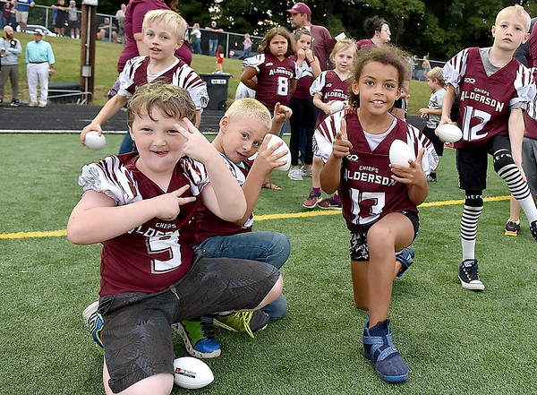 (Brad Davis/The Register-Herald) Young players from the local youth football league react to the camera as they wait for Greenbrier East players to rush onto the field Friday night in Fairlea.