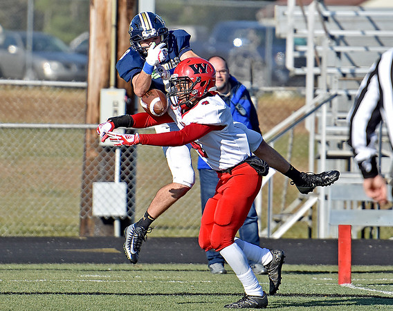 (Brad Davis/The Register-Herald) Nicholas County receiver Nick Kiser just misses hauling in a deep throw in the endzone as the play is broken up by Weir defensive back Quincy Dameron Saturday afternoon in Summersville.
