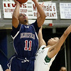 (Brad Davis/The Register-Herald) Bluefield's Mookie Collier drives and scores as First Love's Jason Eubank defends during the Little General Battle for the Armory Tournament Friday night at the Beckley-Raleigh County Convention Center.