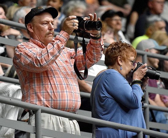 (Brad Davis/The Register-Herald) Family members snap photos from the balcony during Independence's graduation Saturday afternoon.