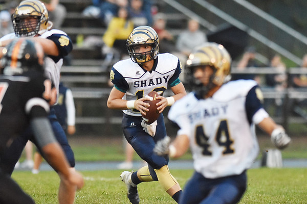 Shady Spring quarterback Drew Clark (10) looks to run during their high school football game Friday in Hinton. (Chris Jackson/The Register-Herald)