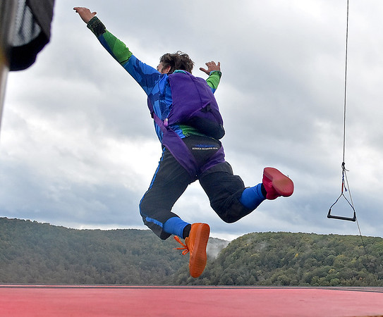 (Brad Davis/The Register-Herald) A B.A.S.E. jumper leaps from the main platform towards glory, and the New River during Bridge Day Saturday in Fayetteville.