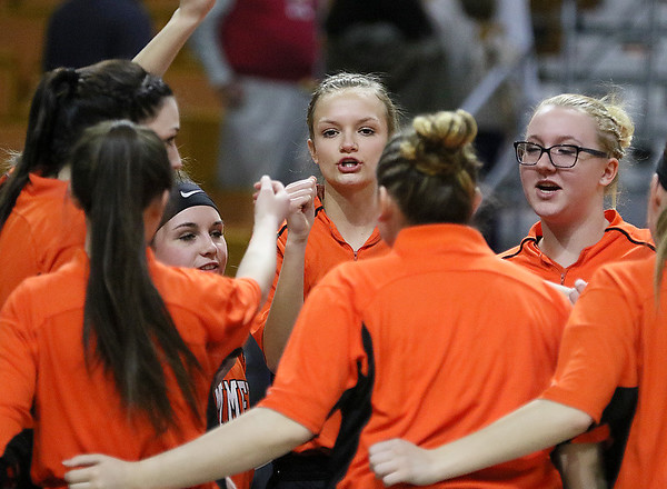 (Brad Davis/The Register-Herald) Summers County player Gavin Pivont and her Lady Bobcats teammates get fired up Friday night at the Charleston Civic Center.