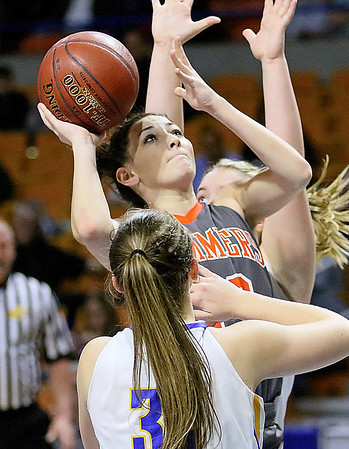(Brad Davis/The Register-Herald) Summers County's Hannah Taylor drives to the basket as St. Joseph Central's Paige Shy defends Friday night at the Charleston Civic Center.