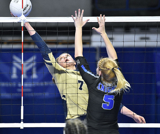 (Brad Davis/The Register-Herald) Greenbrier West's Kenley Posten reaches back to get a hand on the ball as Tyler Consolidated's Josey Jones moves over to block during State Volleyball Tournament action Friday morning at the Charleston Civic Center.