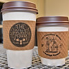 (Brad Davis/The Register-Herald) The Chocolate Moose's Raleigh General Hospital location will have its very own cup sleeves (right), which feature an illustration from artist Hunter Warden of a doctor and patient moose.