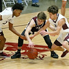 (Brad Davis/The Register-Herald) Woodrow Wilson's Mikey Penn, left, and Danny Bickey pounce on a oose ball coughed up by Virginia Episcopal's Bryce Waterman as the two apply pressure during the Little General Battle for the Armory Tournament Friday night at the Beckley-Raleigh County Convention Center.