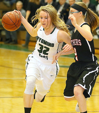 (Brad Davis/The Register-Herald) Wyoming East's Gabby Lupardus hustles up the court as she holds off PikeView defender Cheyanne Graham Thursday night in New Richmond.