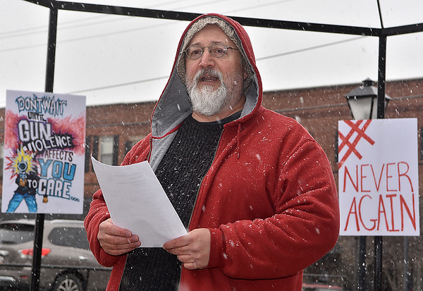 (Brad Davis/The Register-Herald) Wes McCue reads the names of every victim of the recent Parkland, Florida shooting prior to a moment of silence during Beckley's March For Our Lives rally Saturday afternoon at Shoemaker Square.