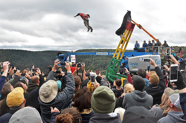 (Brad Davis/The Register-Herald) Spectators cram around the catapult to watch jumpers get launched from the deck during Bridge Day Saturday morning in Fayetteville.