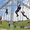 (Brad Davis/The Register-Herald) A group of Spartan racers labor through another brutal obstacle on their way to glory during the annual Spartan Race event Saturday afternoon at the Summit.