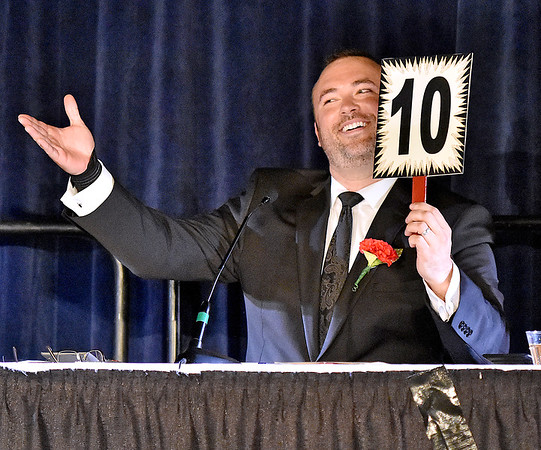 "(Brad Davis/The Register-Herald) Judge Matt Barber scores a ""10"" during the United Way of Southern West Virginia's Dancing With the Stars fundraising event Friday night at the Beckley-Raleigh County Convention Center."