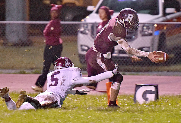 (Brad Davis/The Register-Herald) Woodrow Wilson's Logan Cook reaches out and scores a 2nd quarter touchdown at the pylon just before George Washington defender Gary Smith III can catch him Friday night in Beckley.