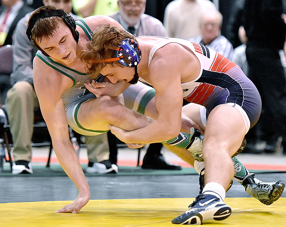 (Brad Davis/The Register-Herald) Fayetteville's Trent Pullens takes on Independence's Connor Gibson for the Class A/AA 160-pound weight class championship during State Wrestling Tournament action Saturday night at the Big Sandy Arena. Indy's Gibson won the match.
