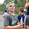 (Brad Davis/The Register-Herald) Six-year-old Crescent Elementary student Blake Henderson reacts to kudos from friends after his rocket had a perfect flight during the Rocket Boys Festival Saturday.