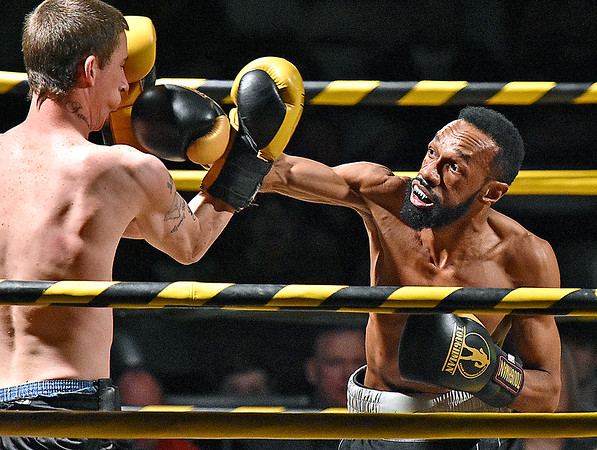 (Brad Davis/The Register-Herald) Charles Moore Jr., right, takes on Josh Ayers during their match in the Original Toughman Contest Friday night at the Beckley-Raleigh County Convention Center.