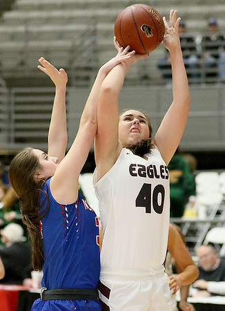 (Brad Davis/The Register-Herald) Woodrow Wilson's Madison Miller drives and scores against Morgantown during Big Atlantic Classic action Thursday night at the Beckley-Raleigh County Convention Center.