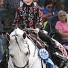 Alainna Sharp, 8, of Fayetteville smiles after winning first place in Western Pleasure Showmanship at the West Virginia State Fair Friday. (Jenny Harnish/The Register-Herald)