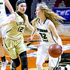 (Brad Davis/The Register-Herald) Wyoming East's Gabby Lupardus drives up the court as Lincoln's Victoria Sturm defends Wednesday afternoon at the Charleston Civic Center.