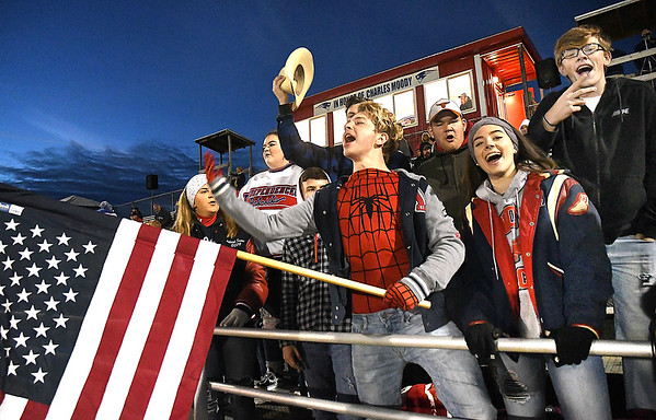 Independence student section reacting after Independence scored a touchdown against Liberty at Independence High School Friday night.<br /> (Rick Barbero/The Register-Herald