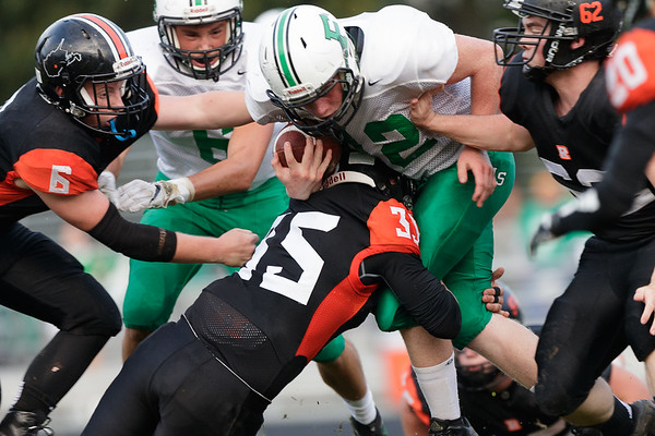 Fayetteville running back, Sammy Pullens tries to break through the line but can't get by Richwood's Doye Ward (35). Chad Foreman for the Register-Herald.