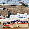 (Brad Davis/The Register-Herald) Crew members Devin Dempsey, left, and Josh Steele wrap hay bail barriers before putting them into place as they and others prepare a moto-cross dirt track inside the Beckley-Raleigh County Convention Center in preparation for the Tristate MX Indoor Championship Series Thursday afternoon. Running tonight and Saturday at 7:00 p.m., the two-night dirt bike racing event is open to area participants of all ages and classes including beginner and youth, with proper gear and their own dirtbikes required. Sign-ups will begin today at the Convention Center at 10:00 a.m. and on Saturday at 9:00 a.m. This will be the first of four events for the Huntington-based series, which will travel to Lexington, Kentucky for their next event two weeks after this. Potential riders will be checked for safe equipment and asked to sign waivers.