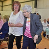 "(Brad Davis/The Register-Herald) Lifelong Bradley resident Lula Thompson, right, is full of joy as she's escorted by granddaughter Valinda Newman to the front of the room to see a special cake made for her and to be serenaded with ""Happy Birthday"" by the many friends and family in attendance during her 100th birthday celebration Saturday afternoon at Bradley Free Will Baptist Church. Thompson turned 100 on May 1st."