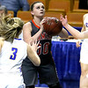 (Brad Davis/The Register-Herald) Summers County's Erica Merrill gets the ball underneath as St. Joseph Central defenders converge on her Friday night at the Charleston Civic Center.