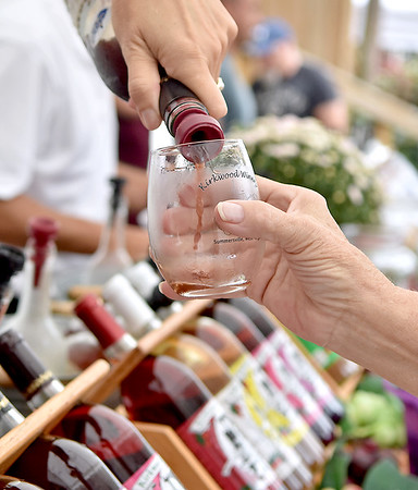 (Brad Davis/The Register-Herald) A sample of wine is poured at the Kirkwood Wine Festival Sunday afternoon in Summersville.