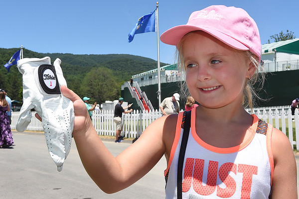 Aubrielle Martin, 6, of Argillite, Ky, looks over a golf she received from pro golfer Sam Saunders during A Military Tribute at The Greenbrier golf tournament held at The Greenbrier Resort in White Sulphur Springs.<br /> (Rick Barbero/The Register-Herald)